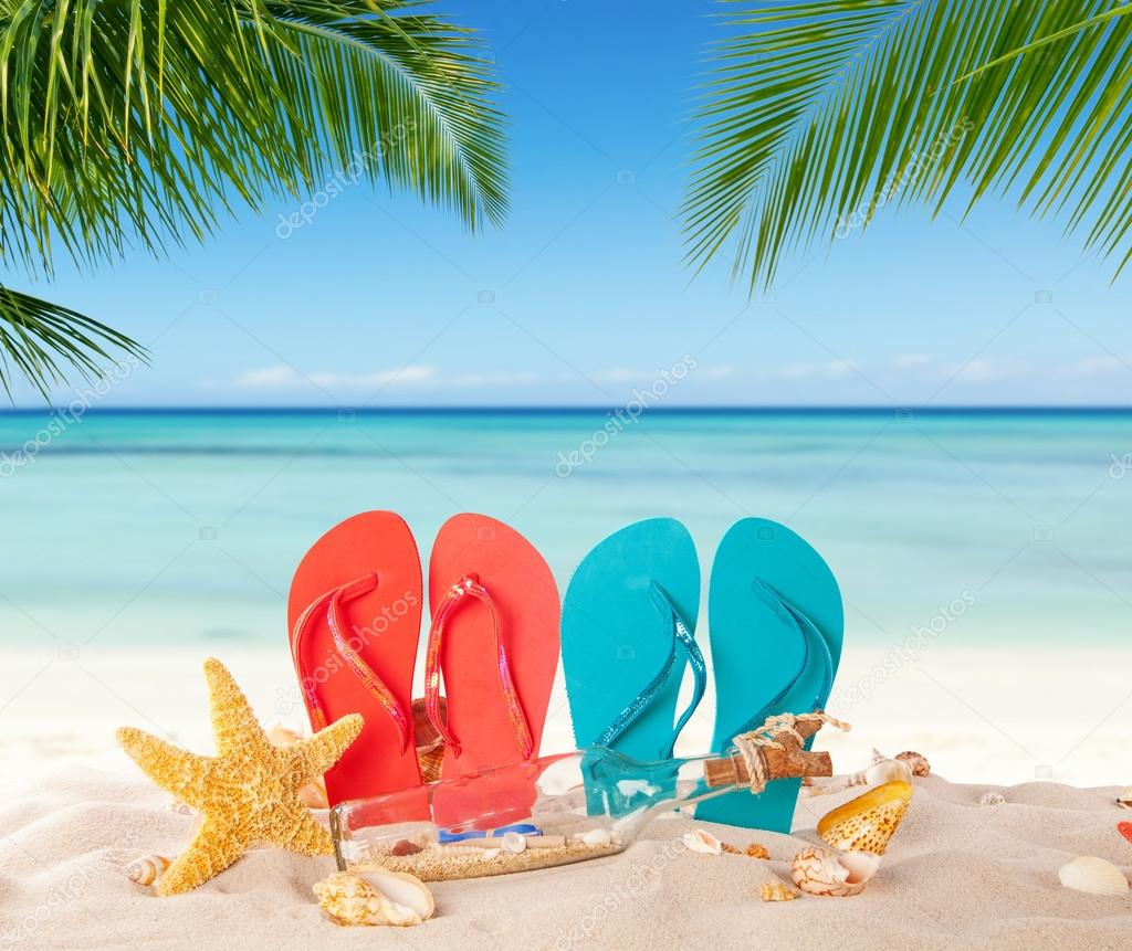 red and blue two pairs of flip flop  for men on beach