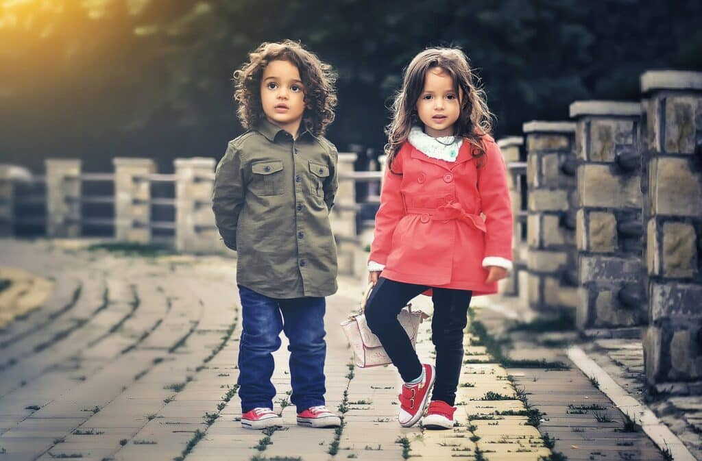 Two Kids girl and boy standing with each other wearing shoes